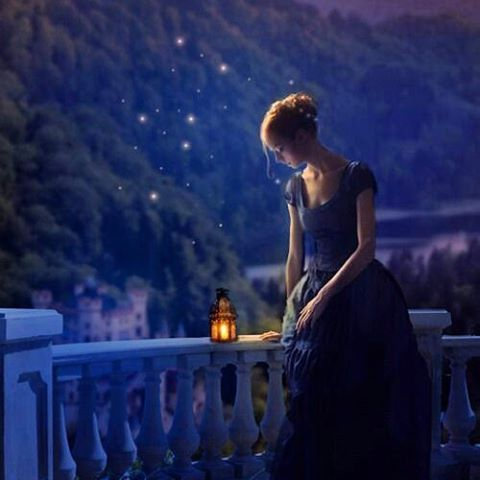 scorpio-young-woman-lantern-mountain-blue-night